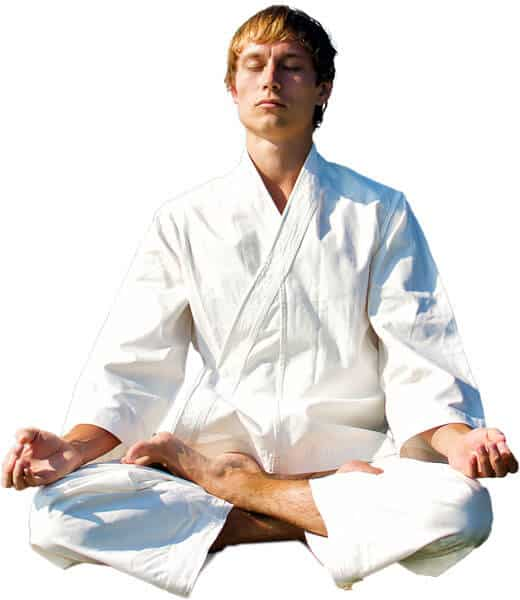 Martial Arts Lessons for Adults in Broomfield CO - Young Man Thinking and Meditating in White