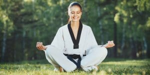 Martial Arts Lessons for Adults in Broomfield CO - Happy Woman Meditated Sitting Background