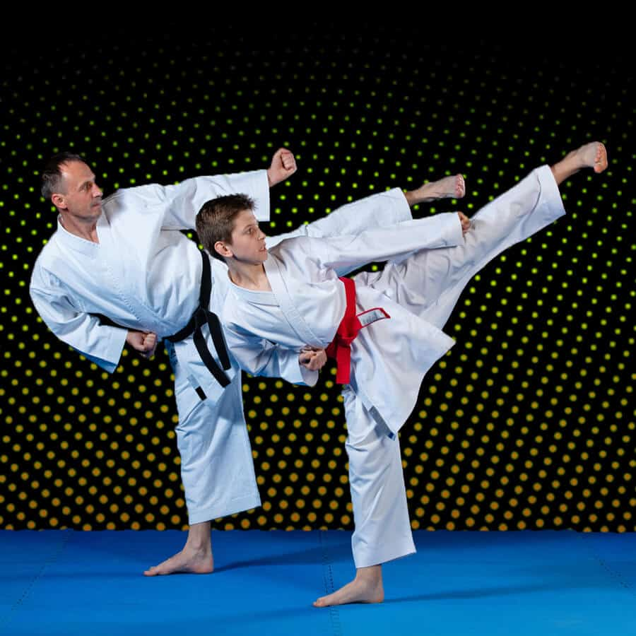 Martial Arts Lessons for Families in Broomfield CO - Dad and Son High Kick